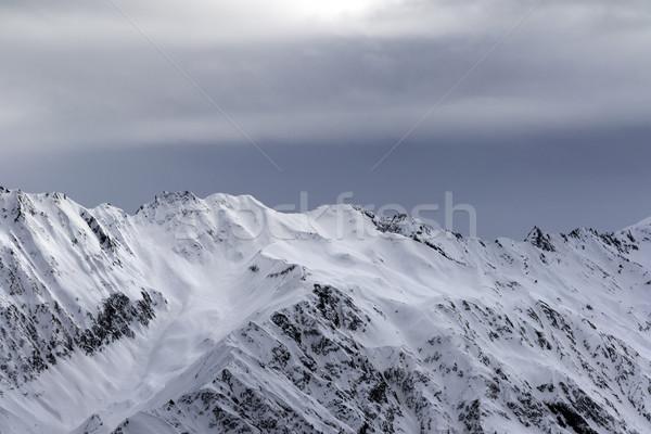 Alto montanhas luz solar tempestade céu nevasca Foto stock © BSANI