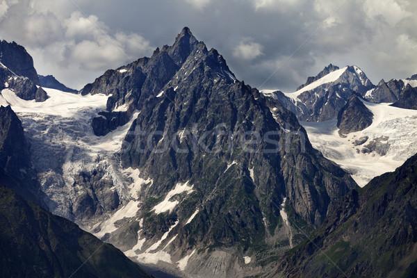 Hegyek gleccser felhők eső Kaukázus Grúzia Stock fotó © BSANI