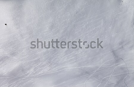 Off-piste slope with traces of skis and snowboarding. Stock photo © BSANI