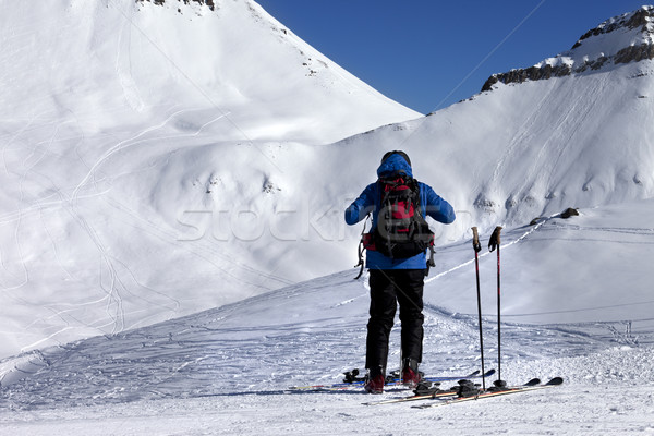 Skier on ski slope at sun day Stock photo © BSANI