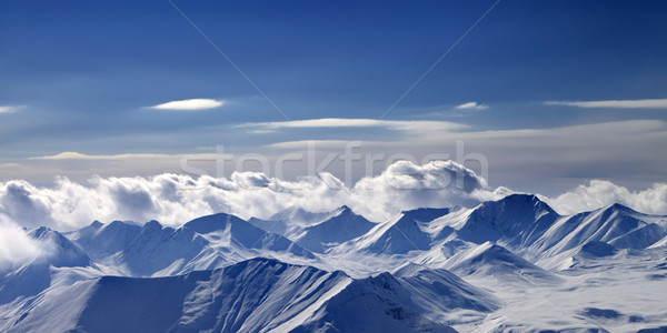 Panoramic view on cloudy mountains in evening Stock photo © BSANI