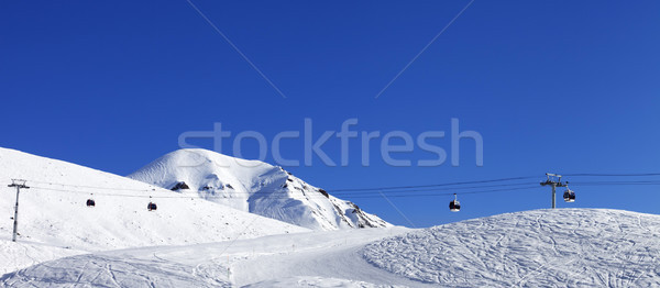 Panoramic view on gondola lift and ski slope at nice day Stock photo © BSANI