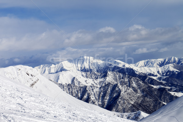Ski slope and snowy mountains Stock photo © BSANI