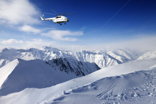 Heliski in snowy mountains Stock photo © BSANI