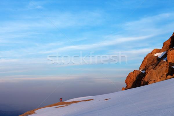 Hiker in sunrise mountains Stock photo © BSANI