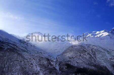 Snowy sunlight mountains, view from ski slope Stock photo © BSANI