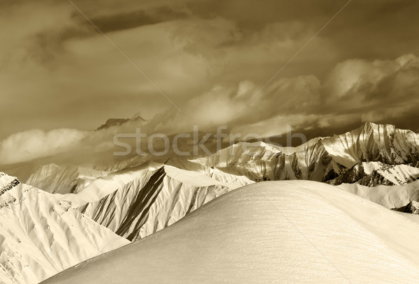 Sepia off-piste snowy slope and cloudy mountains Stock photo © BSANI