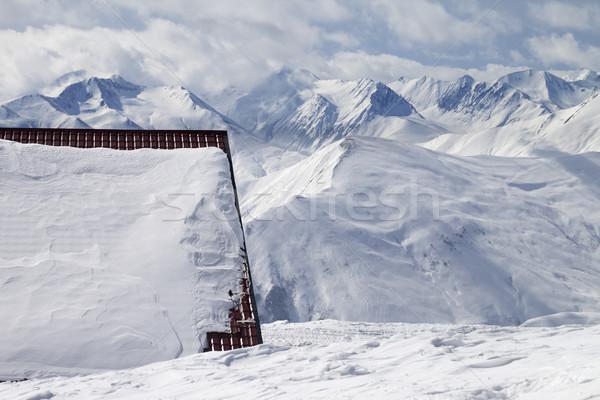 Hotel in snow and ski slope Stock photo © BSANI