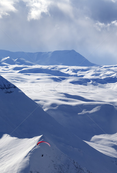 Speed flying in winter evening mountains Stock photo © BSANI