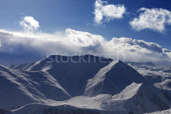 Snow mountains and sunlight clouds in evening Stock photo © BSANI