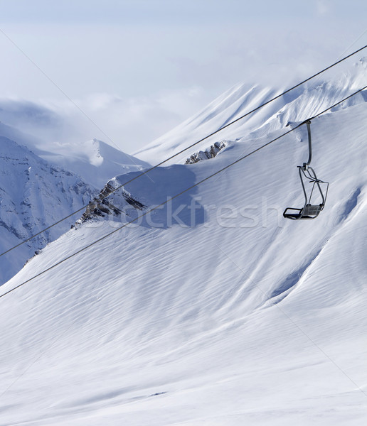 Chair lift at ski resort and off piste slope Stock photo © BSANI