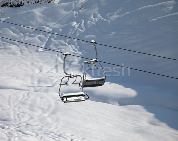 Two chair-lift with snowdrift in sun morning Stock photo © BSANI