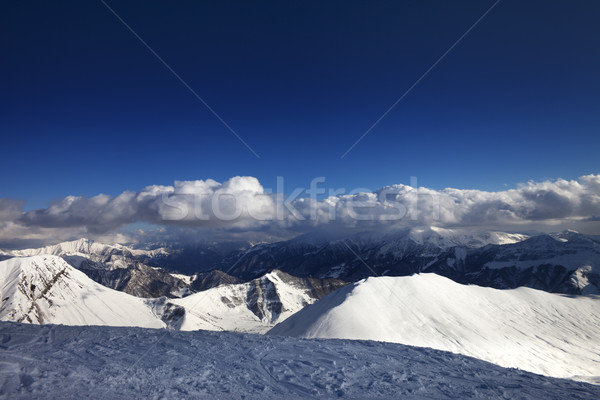 Off-piste slope and beautiful snowy mountains in evening Stock photo © BSANI
