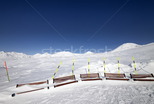 Ski slope and wooden benches in snow Stock photo © BSANI