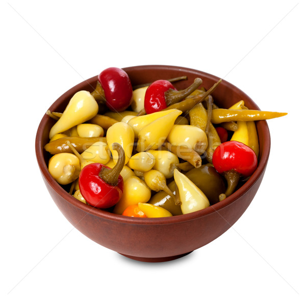 Mix of hot turkish marinated peppers in ceramic bowl Stock photo © BSANI