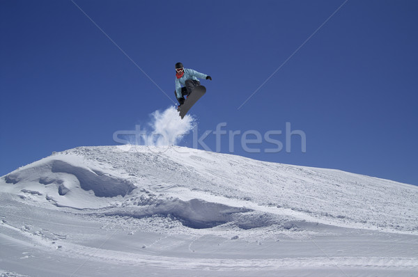 Snowboarder jumping in terrain park Stock photo © BSANI