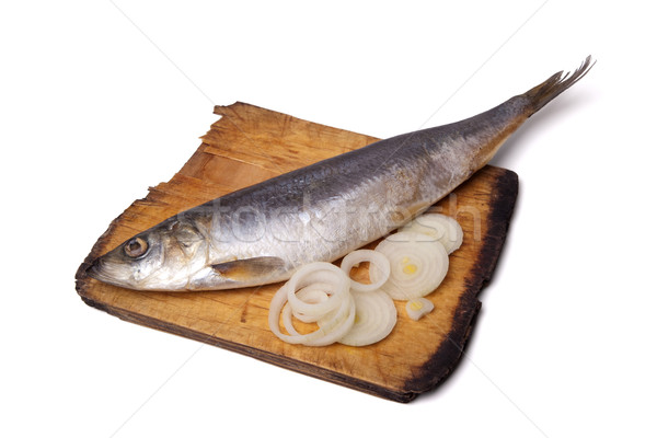 Herring with onion rings on old wooden cutting board Stock photo © BSANI