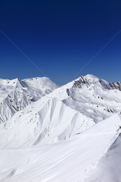 Off-piste slope and blue clear sky in sun day Stock photo © BSANI