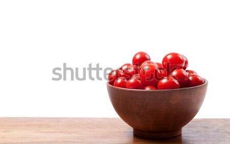 Cherry tomato in ceramic bowl on wooden kitchen table Stock photo © BSANI