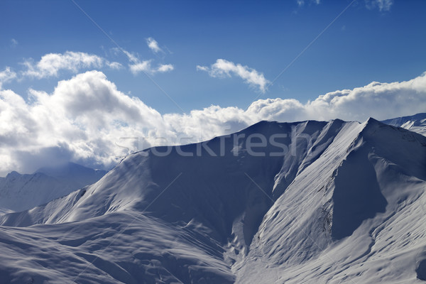 Off piste slope in evening with sunlit clouds Stock photo © BSANI