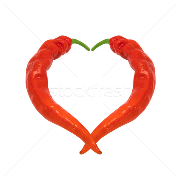 Heart composed of red chili peppers Stock photo © BSANI