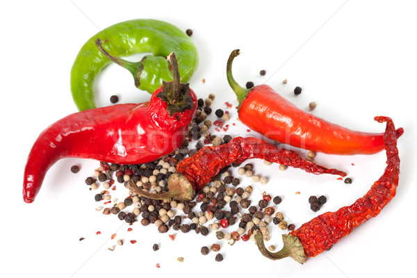 Mix of hot peppers on white background Stock photo © BSANI