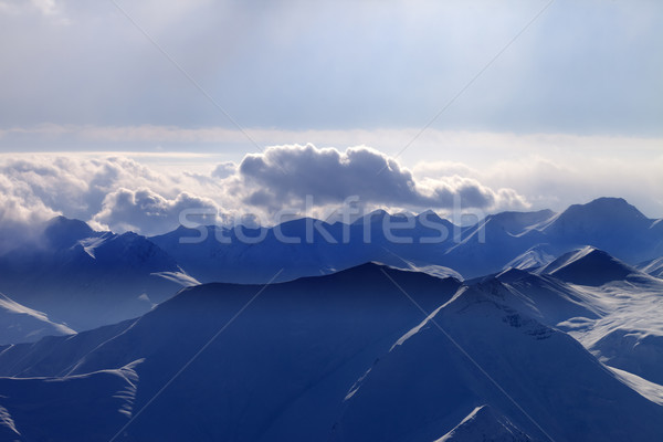 Silhouette of evening mountains in mist Stock photo © BSANI