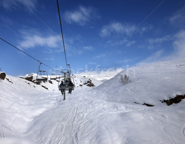 Chair-lift and off-piste slope in sun day Stock photo © BSANI