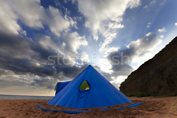 Conical tent on summer beach in evening Stock photo © BSANI