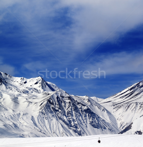 Stock photo: Winter mountains and blue sky with clouds