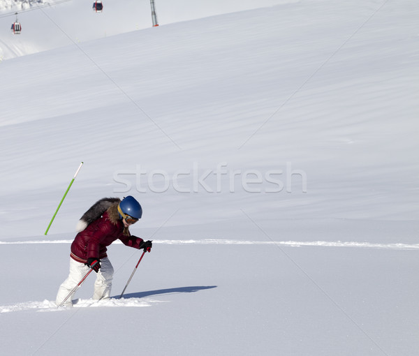 Little skier on off-piste slope with new fallen snow at nice sun Stock photo © BSANI