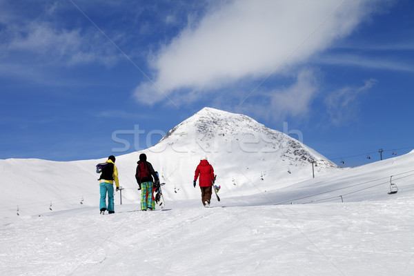 Three snowboarder on slope at sun nice day Stock photo © BSANI
