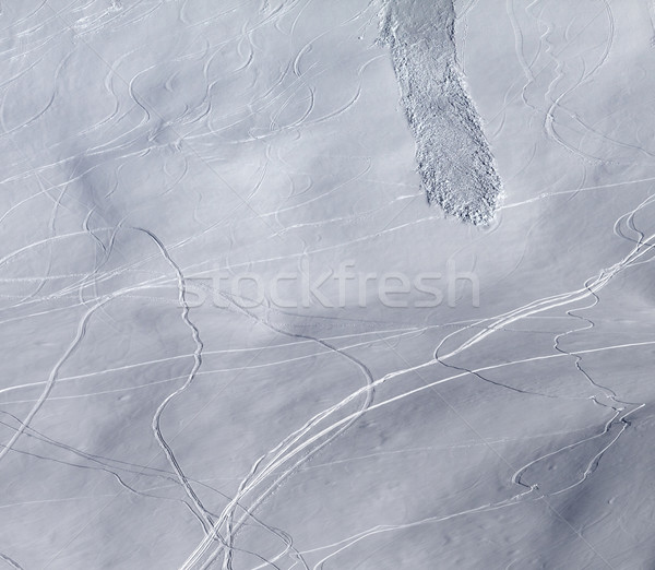 Off-piste slope with traces of skis, snowboarding and avalanche Stock photo © BSANI