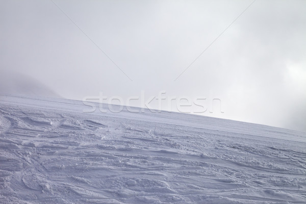 Ski slope for slalom and overcast sky in bad weather Stock photo © BSANI