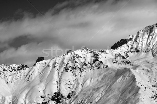 Black and white winter snow mountains at nice sunny day Stock photo © BSANI