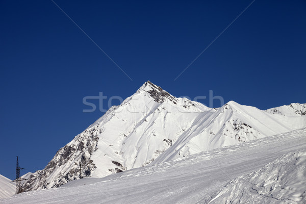 Ski slope and blue clear sky at sunny day Stock photo © BSANI