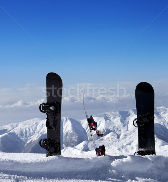 Three snowboards in snow near off piste slope in sun day Stock photo © BSANI
