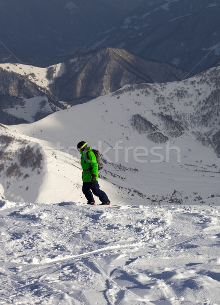 Snowboarder on off-piste slope in sun evening Stock photo © BSANI