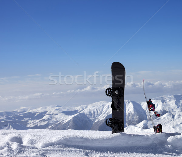 Two snowboards in snow near off-piste slope in sun day Stock photo © BSANI