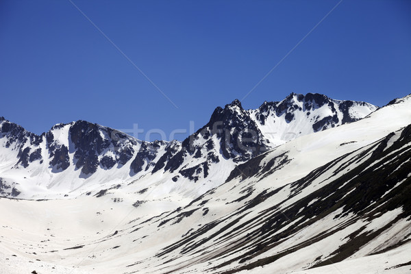 Snowy mountains at nice spring day Stock photo © BSANI