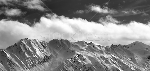 Black and white panoramic view on snow winter mountains and sunl Stock photo © BSANI