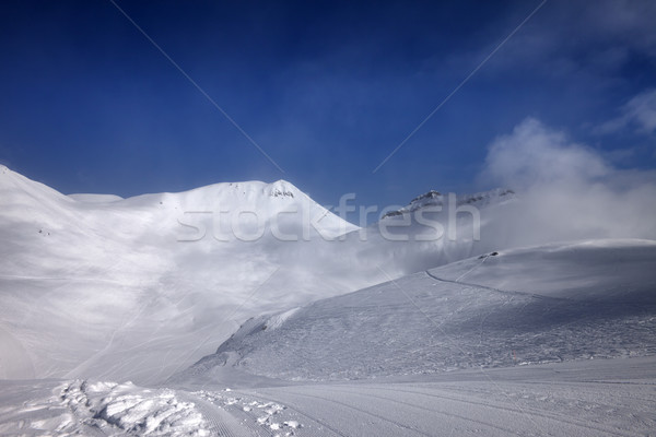 Ski slope with snowmobile trail in nice day Stock photo © BSANI