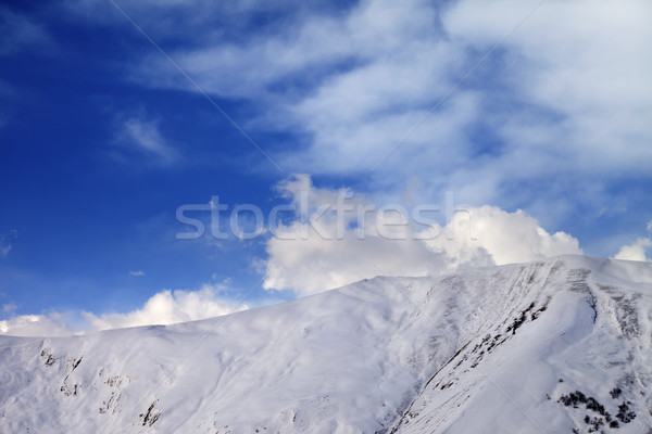 Off-piste slope at evening and sky with clouds Stock photo © BSANI