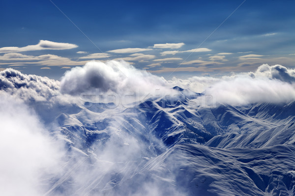 Snow mountains with clouds in evening Stock photo © BSANI