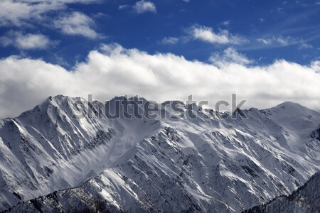Snow winter mountains and cloud sky in sun evening Stock photo © BSANI