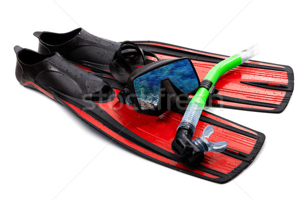 Snorkel, flippers and mask with reflection of blue sea Stock photo © BSANI