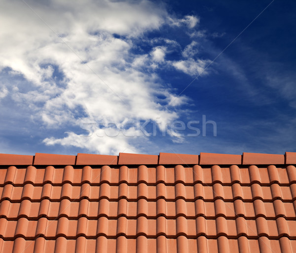 Roof tiles and sky with clouds Stock photo © BSANI