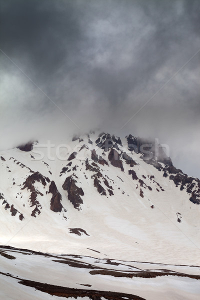 Top of mountains in storm clouds Stock photo © BSANI
