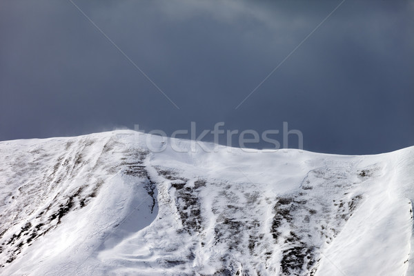 Off-piste slope and storm gray clouds Stock photo © BSANI