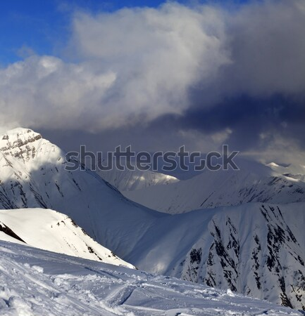 Off-piste slope and mountains with storm clouds Stock photo © BSANI